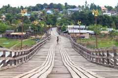 Saphan Mon or Mon Bridge, the longest handmade wooden bridge in Thailand. Stock Photo