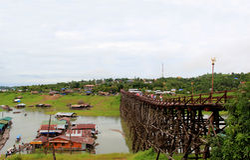 Saphan Mon or Mon Bridge, the longest handmade wooden bridge in. Thailand, was destroyed by flood in 2013 Stock Photo