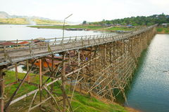 Saphan mon wooden bridge. Saphan mon, or mon bridge. 400 m. long, made by hand, wooden bridge that crosses the khao laem artificial lake, connecting the mon Stock Images