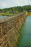 Saphan mon wooden bridge. Saphan mon, or mon bridge. 400 m. long, made by hand, wooden bridge that crosses the khao laem artificial lake, connecting the mon Royalty Free Stock Photography