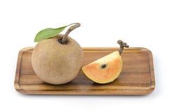 Sapodilla plum, Sapota (Manilkara zapota (L.) P. Royen). Stock Photo