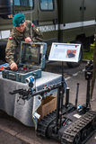 Sapper at control board of Robot TALON. WARSAW, POLAND - MAY 08, 2015:  Sapper at the control board of tracked Robot TALON. 70th anniversary of End of WW II Stock Image