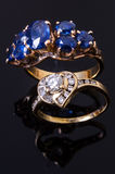 Sapphire gold ring and heart diamond ring Stock Photography