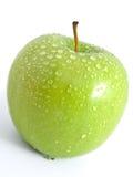 Sappige rijpe groene appel op een witte achtergrond stock afbeeldingen