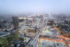 Sapporo cityscape i dimmig dag Arkivfoton