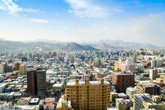 SAPPORO JAPAN - December 22, 2015: Gatasikt av byggnadsaroen Arkivbild