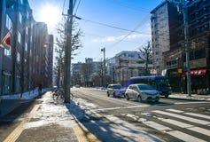 SAPPORO JAPAN - December 22, 2015: Gatasikt av byggnadsaroen Fotografering för Bildbyråer