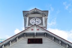 Sapporo, Japan, January 2, 2018: Sapporo Clock Tower is a wooden. Structure and tourist attraction. The iconic wooden clock tower now houses a museum on the stock photography