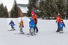 Sapporo, Japan, January 28, 2018: Takino  Suzuran Hillside Park. Offers family fun activities during winter. Featured here children receving ski lessons Royalty Free Stock Photography