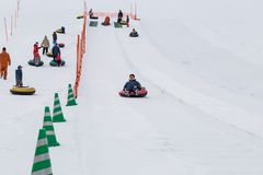 Sapporo, Japan, January 28, 2018: Takino  Suzuran Hillside Park. Offers family fun activities during winter. Featured here kids having fun in snow boarding on Royalty Free Stock Image