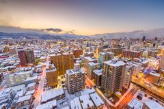 Sapporo, Japan Winter Skyline. View from the mountains at dusk stock photo