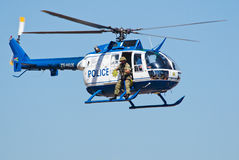 SAPS Bo 105 helicopter and sniper from side stock photos