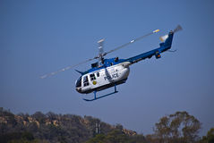 SAPS Helicopter - ZS-HUX. ZS-HUX is one of the 16 BO105s used by the South African Police Service (SAPS) throughout South Africa. Used for various crime royalty free stock images