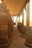 Saqqara, Egypt. JANUARY 31, 2016: People visiting the ruins in the Saqqara, entering and exiting through its main entranceway with large Roman pillars along Royalty Free Stock Photo