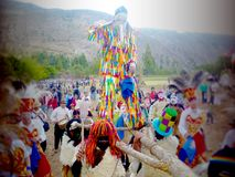 Saqra Pablo in religious festival of the Cusco Valley. Danzantes accompanying the religious procession of the Virgen Natividad in Huayllabamba, Cusco. Every stock photography