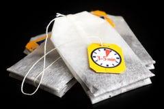 Saquinhos de chá etiquetados com corda Fotografia de Stock Royalty Free