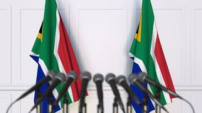 SAR official press conference. Flags of South Africa and microphones. Conceptual 3D rendering. SAR official press conference. Flags of South Africa and stock illustration