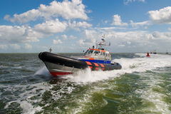SAR rescue boat at sea. Search and Rescue (SAR) lifeboat of the dutch coast guard in action at open sea royalty free stock images