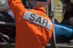 SAR  Search and Rescue  logo on a pilot from a  rescue helicopter Royalty Free Stock Images