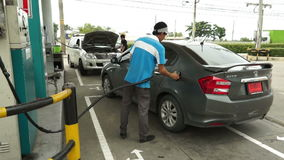 SARABURI, THAILAND - APRIL 10 2015 : Thai staff of fuel stations serve fueling cars. The fuel type call stock footage