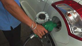 SARABURI, THAILAND - APRIL 10 2015 : Thai staff of fuel stations serve fueling cars. The fuel type call stock video