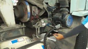 SARABURI, THAILAND - APRIL 10 2015 : Thai staff of fuel stations serve fueling cars stock video