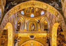 Saracen arches and Byzantine mosaics within Palatine Chapel of the Royal Palace in Palermo Stock Photo