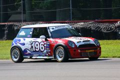 Sarah Cattaneo. Races the Mini Cooper S at the professional motorsports racing event, International Motor Sports Association, Sports car club of America, WC Royalty Free Stock Image