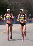 Sarah Crouch USA and Spence Gracey, Neely (USA)  races up the Heartbreak Hill during the Boston Marathon. BOSTON - APRIL 18: Sarah Crouch (USA) and Spence Gracey Stock Image
