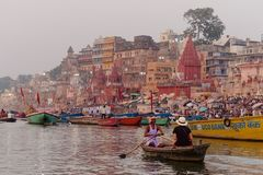 Sarah enjoys a sunrise row down the Ganges Varanasi- an India must see. It's a surreal feel floating along the Ganges in front of one of the frames of India I Royalty Free Stock Photography