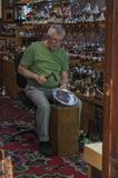 Sarajevo, Bascarsija, Coppersmith Street, store, shopping, souvenir, old town, skyline, bazaar, blacksmith. Sarajevo, Bosnia and Herzegovina: coppersmith at work royalty free stock photo