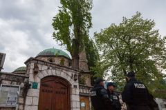 Bosnian police units wearing bulletproof jackets patrolling in front of one of the mosques of the city center of Sarajevo. SARAJEVO, BOSNIA AND HERZEGOVINA Royalty Free Stock Photos