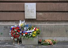 Wreath and flowers on oplace of death of people in bosnian war. Sarajevo, Bosnia and Herzegovina - December 18, 2017: wreath and flowers on place of death of Stock Images