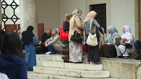 SARAJEVO, BOSNIA - MARCH 2014: Women at Ba�?ar�ija mosque in capital city of Bosnia, Sarajevo which is know for it's mixture