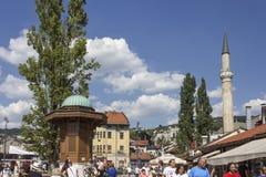 Sarajevo city centre at day time in summer season, with the sebilj fountain and people around. SARAJEVO, BOSNIA AND HERZEGOVINA - AUGUST 18 2017: Sarajevo city Stock Image