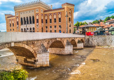Sarajevo city hall Bosnia. Newly renovated city hall in Bosnian capital, view at old city center Sarajevo with river Miljacka in foreground Stock Photos