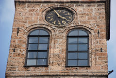 Sarajevo clock tower. Famous Ottoman tower clock with arabic numerals in Sarajevo, Bosnia and Herzegovina Stock Images