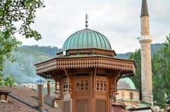 Sarajevo Sebilj and minaret Stock Images