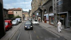 Sarajevo. View through the rear window of a moving tram. August 11, 2015. Bosnia and Herzegovina, Sarajevo. View through the rear window of a moving tram on stock video footage