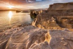 Sarakiniko. Greek rocky shore at sunset Stock Photos