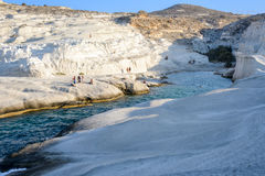 Sarakiniko with people, Melos, Greece Stock Photography