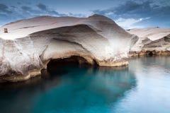 Sarakiniko. Soft shaped cave rock by the sea Stock Photos