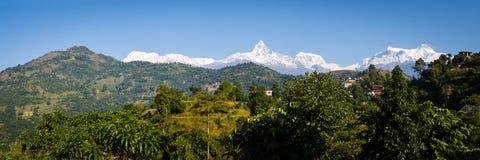 Sarangkot and the Annapurna Range. View to Sarangkot and the Annapurna Himalayan Range from a ridge above Pokhara, Nepal stock photography
