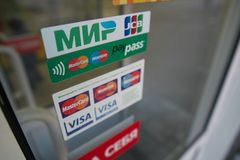Payment. SARANSK, RUSSIA - MAY 22, 2019: Logos accepted payment systems on the door of the store royalty free stock images