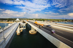 Sarasin Bridge. In 1970, the Sarasin Bridge was built to help connect Phuket Island to the mainland of Thailand. This enabled the tremendous expansion of trading stock photo