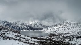 Sarathang lake surrounded by snow covered mountains on all side near Changu lake in May, Sikkim. India Royalty Free Stock Photos