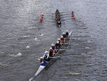 Saratoga (bottom) and Marin Rowing(top) races in the Head of Charles Regatta Women's Youth Eights Stock Photo