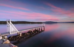 Saratoga Jetty sunset. Saratoga jetty at sunset with soft light and  pink and blue hues.  Perfect place to relax or fish Stock Images