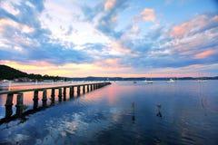 Saratoga Sunset. Jetty wharf and yachts moored at Saratoga on the Central Coast, Australia Stock Photo