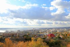 The city of Saratov on the bank of the Volga River against the blue sky. View from the Sokolovaya Mountain. stock photography